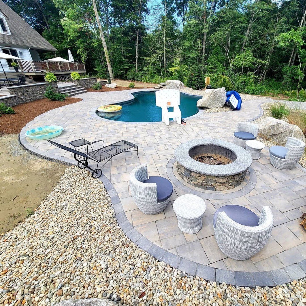 Outdoor Pool Area With Natural Stone Veneer Features