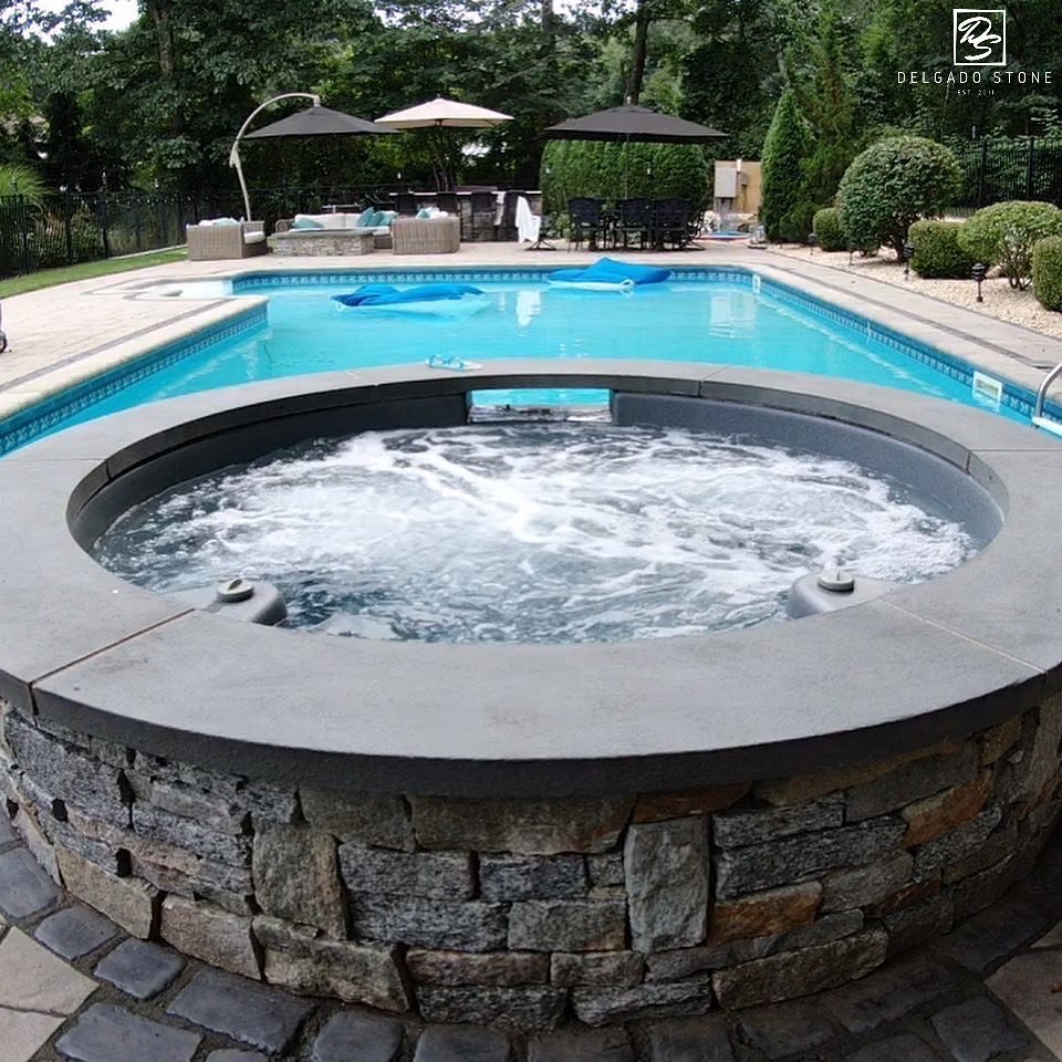 Spill Over Spa With Natural Stone Veneer